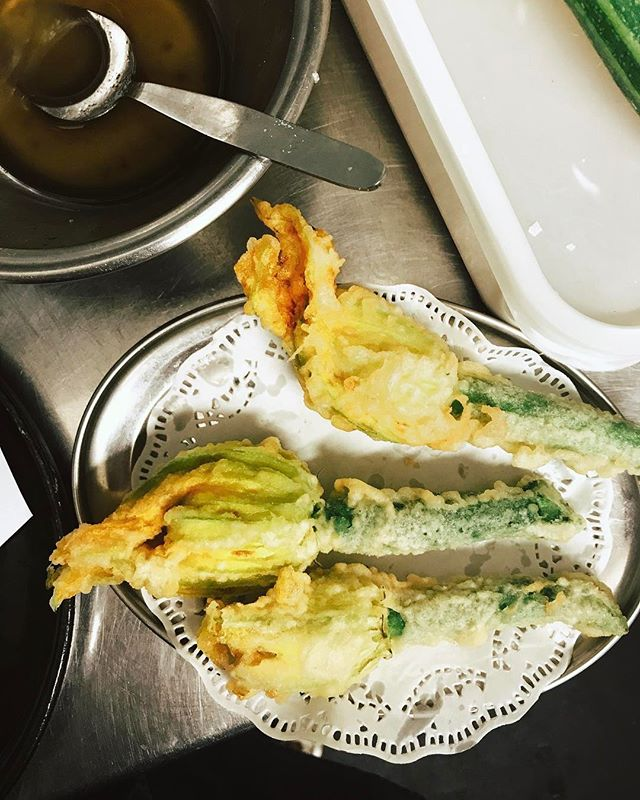 From yesterday's @koyabar takeover @wildcountry_organics @londonfarmers courgette blossoms, filled with whipped, smoked cod's roe and served with yuzu, expertly fried until warm yet slightly runny in the centre by @sunil_bhangu