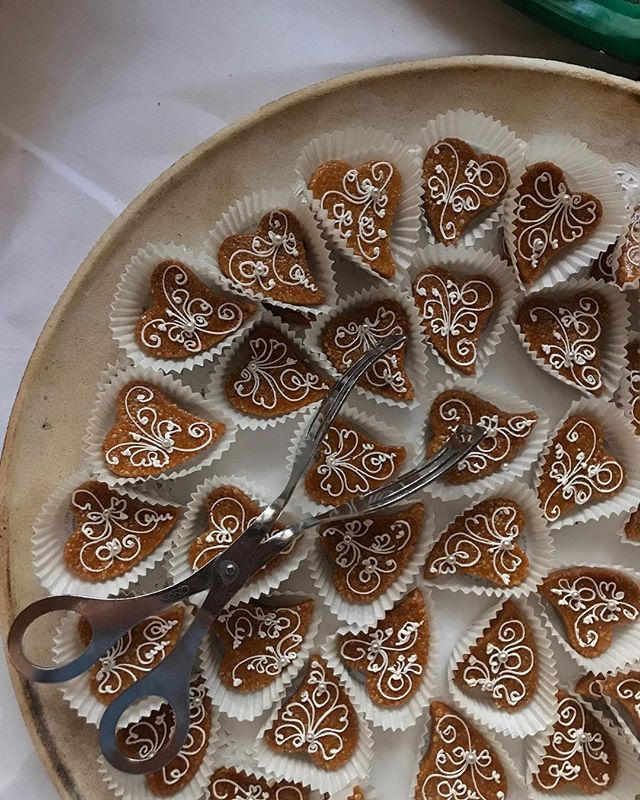 Lace-like piping on traditional honey biscuits.